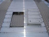 Offset underfloor storage tray