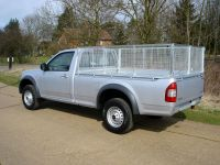Isuzu Rodeo Pick Up Conversion - Cages with rear barn door. Calvanised steel toolbox. Full width alloy toolbox mounted on body to allow for full load length.
